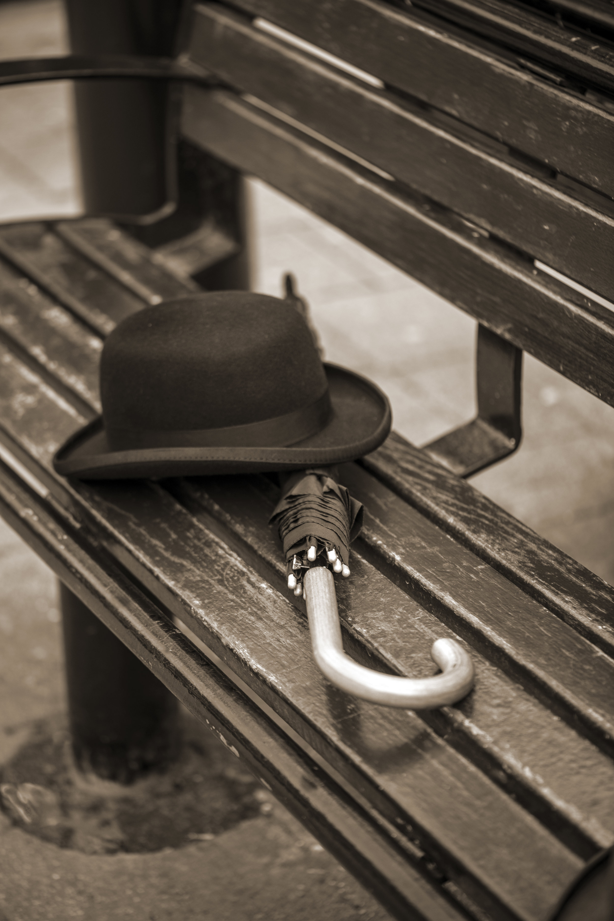 Bowler and brolly on bench Hereford.jpg
