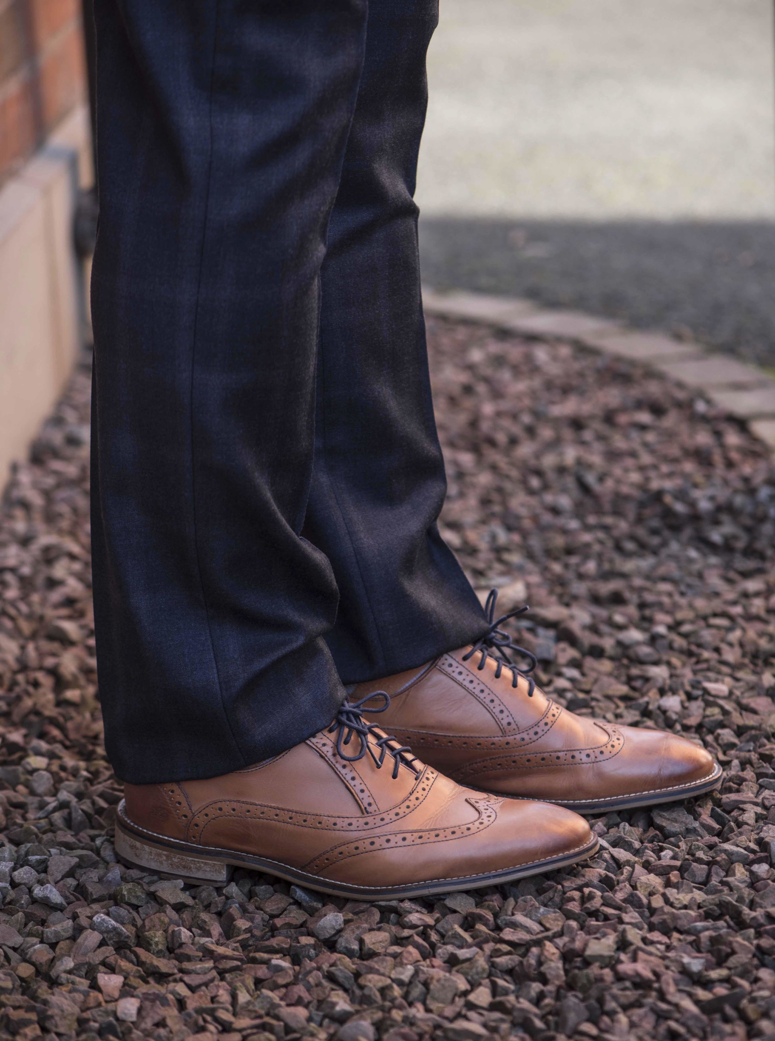Checked trousers and tan mens shoes.jpg