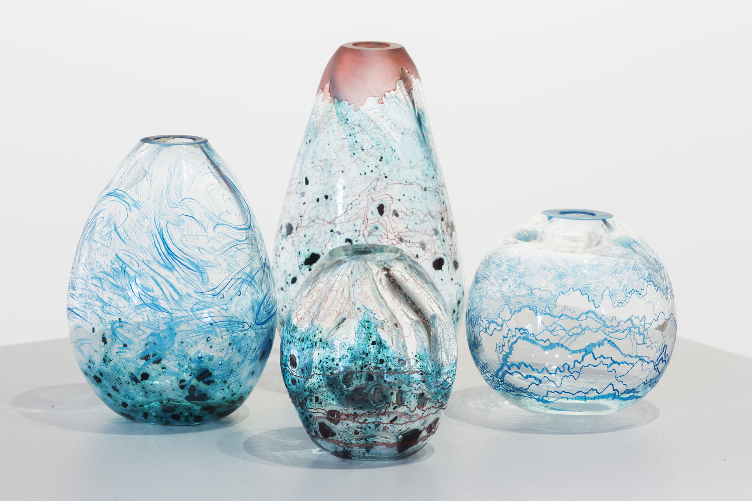 Annika Romeyn, Fluid, Sediment and Contour Vessels, blown and engraved glass with copper inclusions and oil paint, 2014 (photo by Adam McGrath), Canberra Glassworks GLINT exhibition install