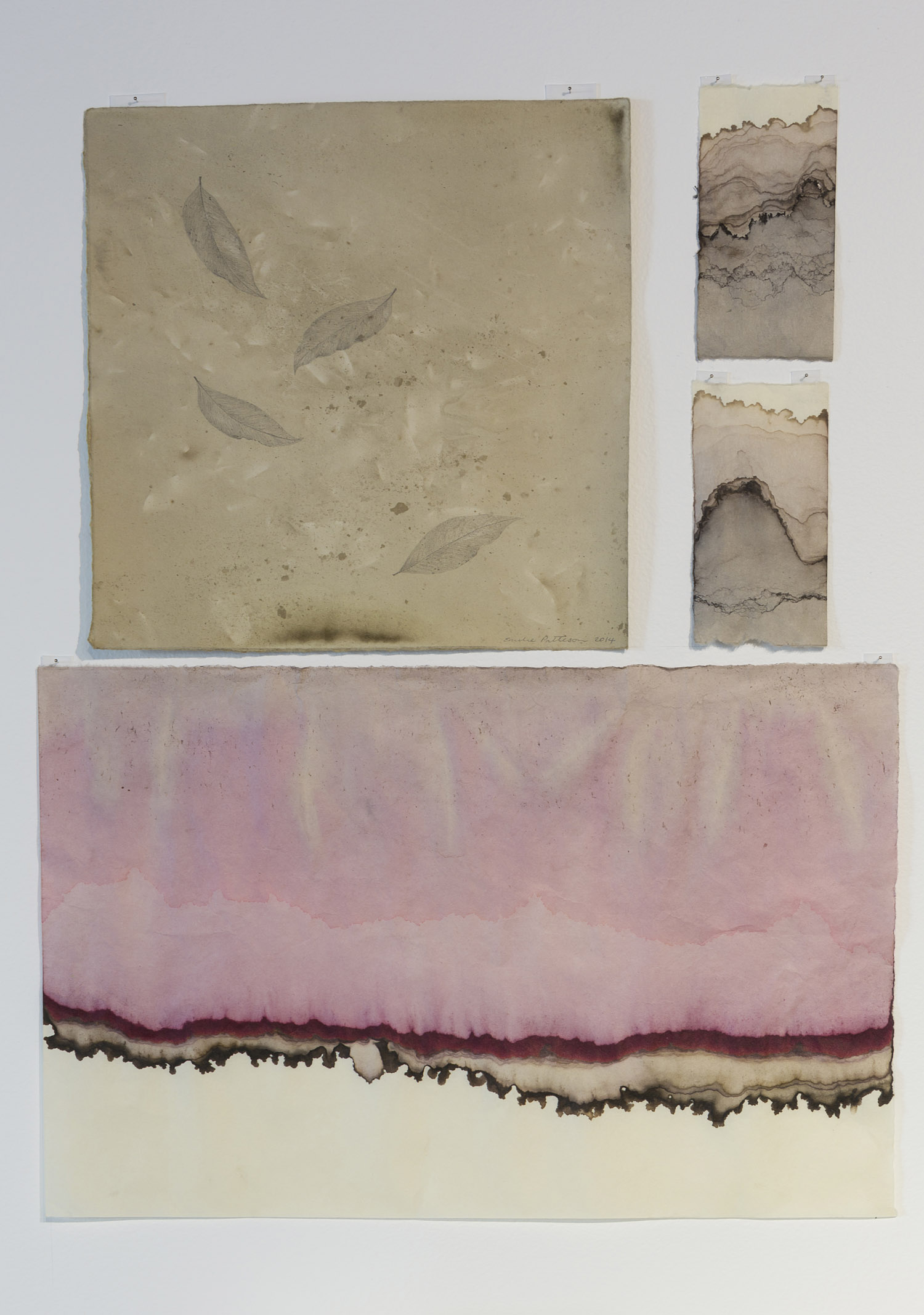 Infusion by Emilie Patteson (top left) with Topography by Annika Romeyn (right and bottom), natural dyes on paper, 2014, (photo by Adam McGrath), Canberra Glassworks GLINT exhibition install