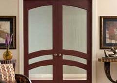CUSTOM & MANUFACTURED DOORS — curved wood moldings Thomas