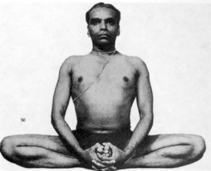 The great Mr. Iyengar in Baddha Konasana.  Plate 101 in B.K.S. Iyengar (1966),  Light on Yoga.