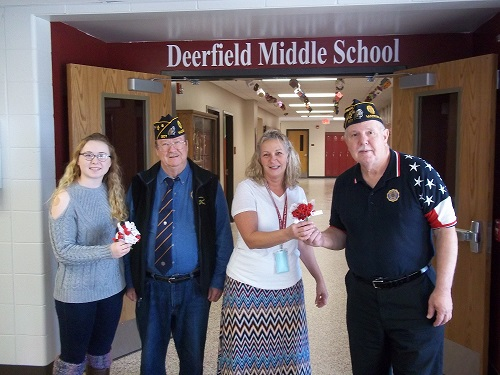 Post 501 Cdr. Tom Stolarczyk & Bill Robbins presenting poppies to the Deerfield High School Veterans Day Program on 11-9-2016.  Overseeing the program are Maria Furguson & Elizabeth Johnson.