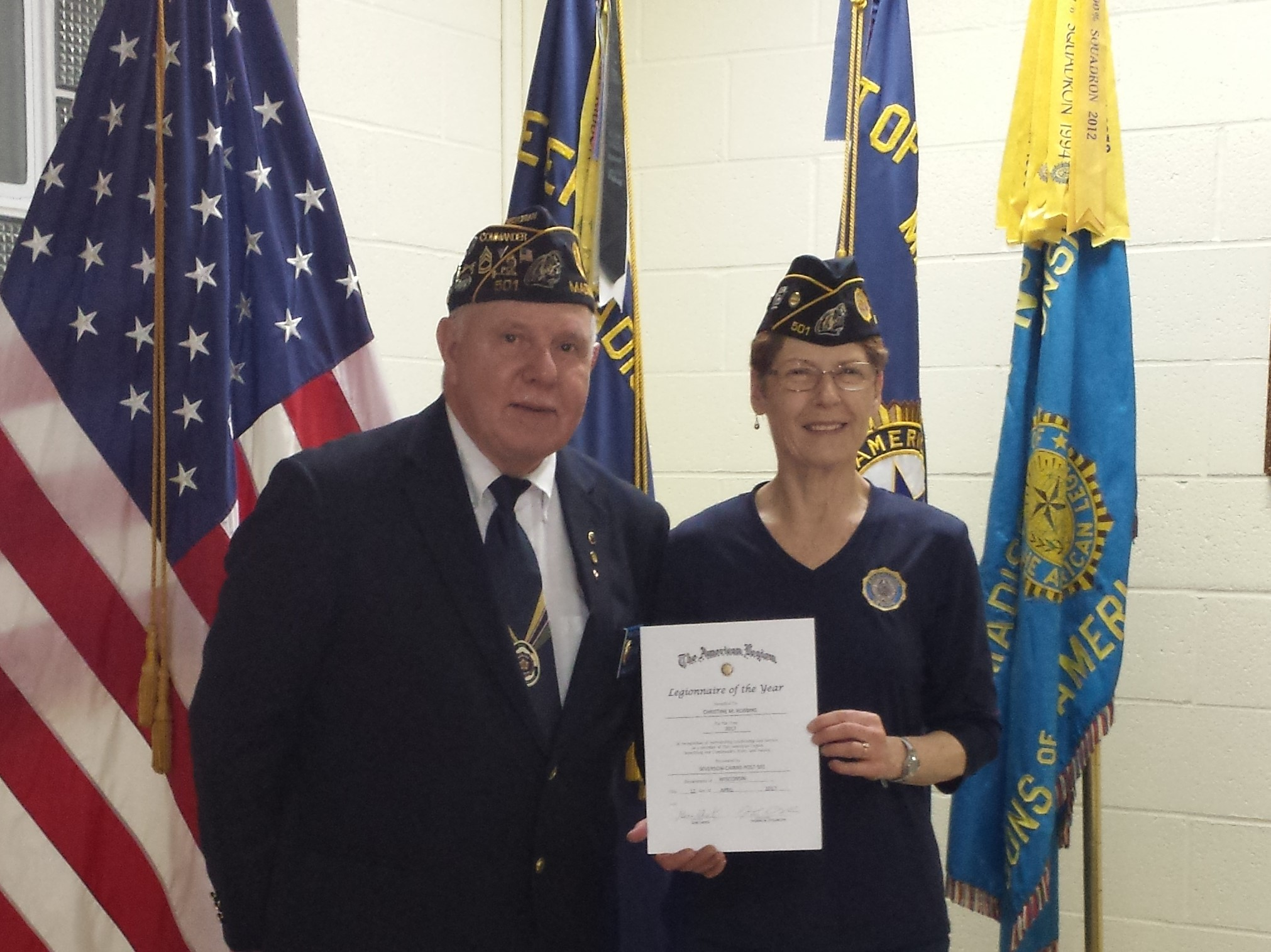 "Legionnaire Christine Robbins awarded the 2017 ""Legionnaire Of The Year"" by Post 501's Cdr. Thomas Stolarczyk, 5/10/2017."