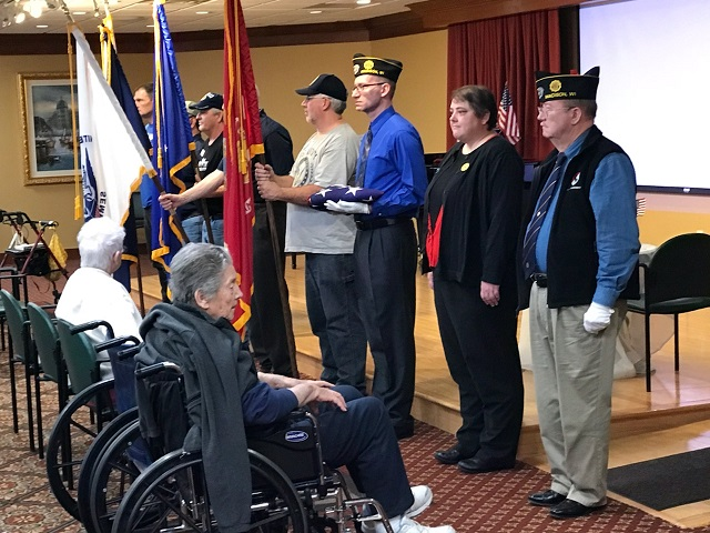 Veteran Service at Oak Park Place on 11/10/2017.  Post 501 members:  Eric Beuermann, William Robbins, Post Cdr. Thomas Stolarczyk, Unit 501 Auxiliary President Rebecca Lovell.