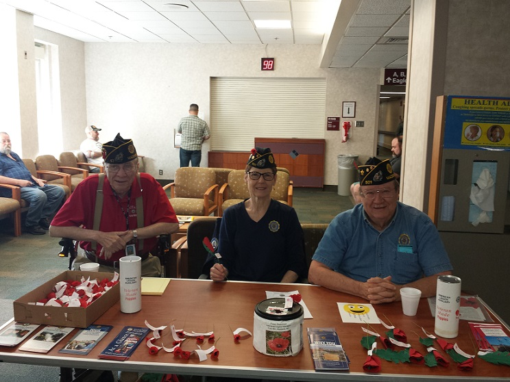 Legionnaires Don Schaefer, Chris Robbins, and William Robbins distributing Poppies at the Veterans Hospital, Middleton, WI, on 5-18-2018.