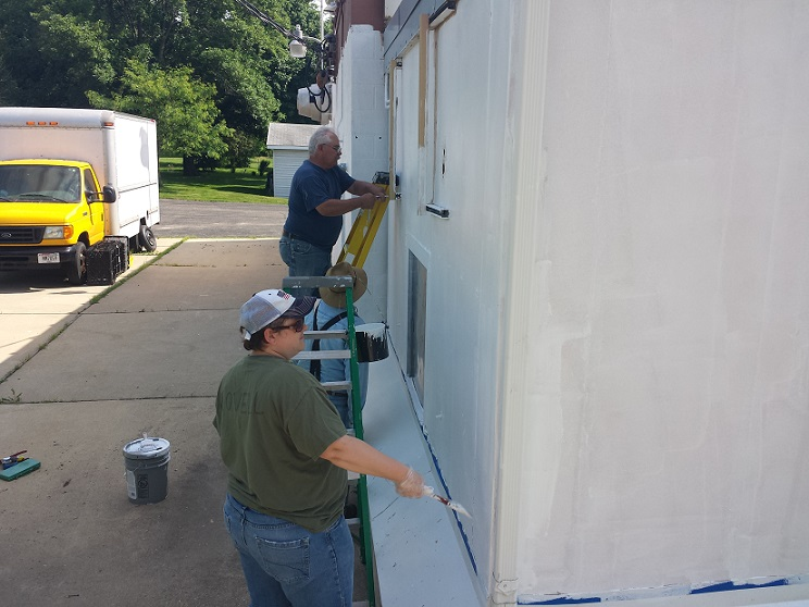 Rebecca, Keith & Bill priming east side of Post 501 - 6-6-2018.