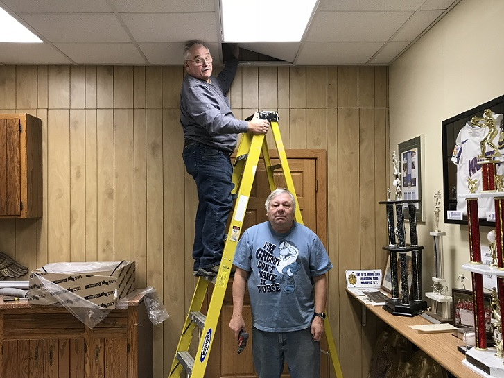 Keith & Jerry installing the last new ceiling tile in Post 501's Auxiliary & History Room. Well done fellas.