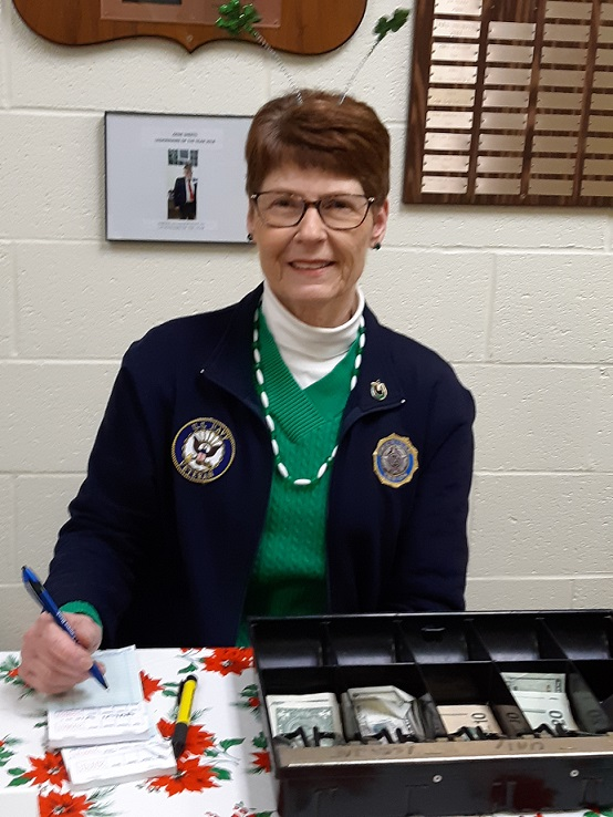 Legionnaire Chris, Post 501's cashier, is all smiles at Post 501's corned beef & cabbage dinner on 3/9/2019.