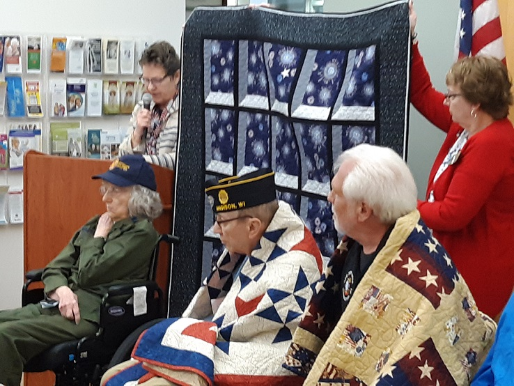Displaying of Quilt of Valor for Sherry Schaefer.