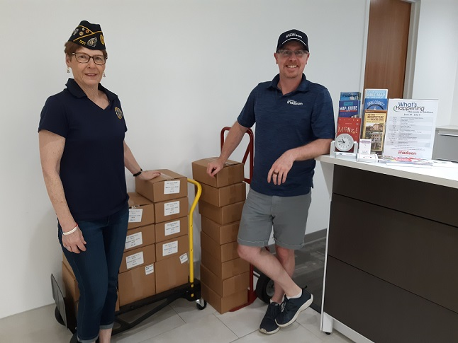 Legionnaire Chris Robbins receiving Madison Visitor Guides & Maps from Eric at the Madison Conv. & Visitor Bureau on 7/1/2019.