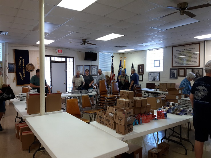 Post 501 volunteers assembling bags on July 10th for attendees at the WI Dept. of Am. Legion Convention.