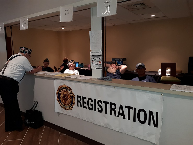 Legionnaire volunteers working at the convention registration booth.
