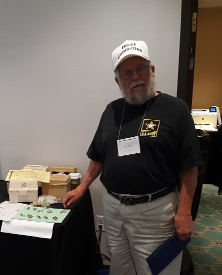 Gene fundraising with the past convention pins and fishing lures.