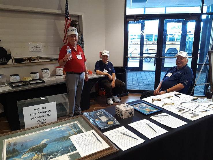 Phil, President Host Committee, John and Jerry working at the silent auction and raffle tables.