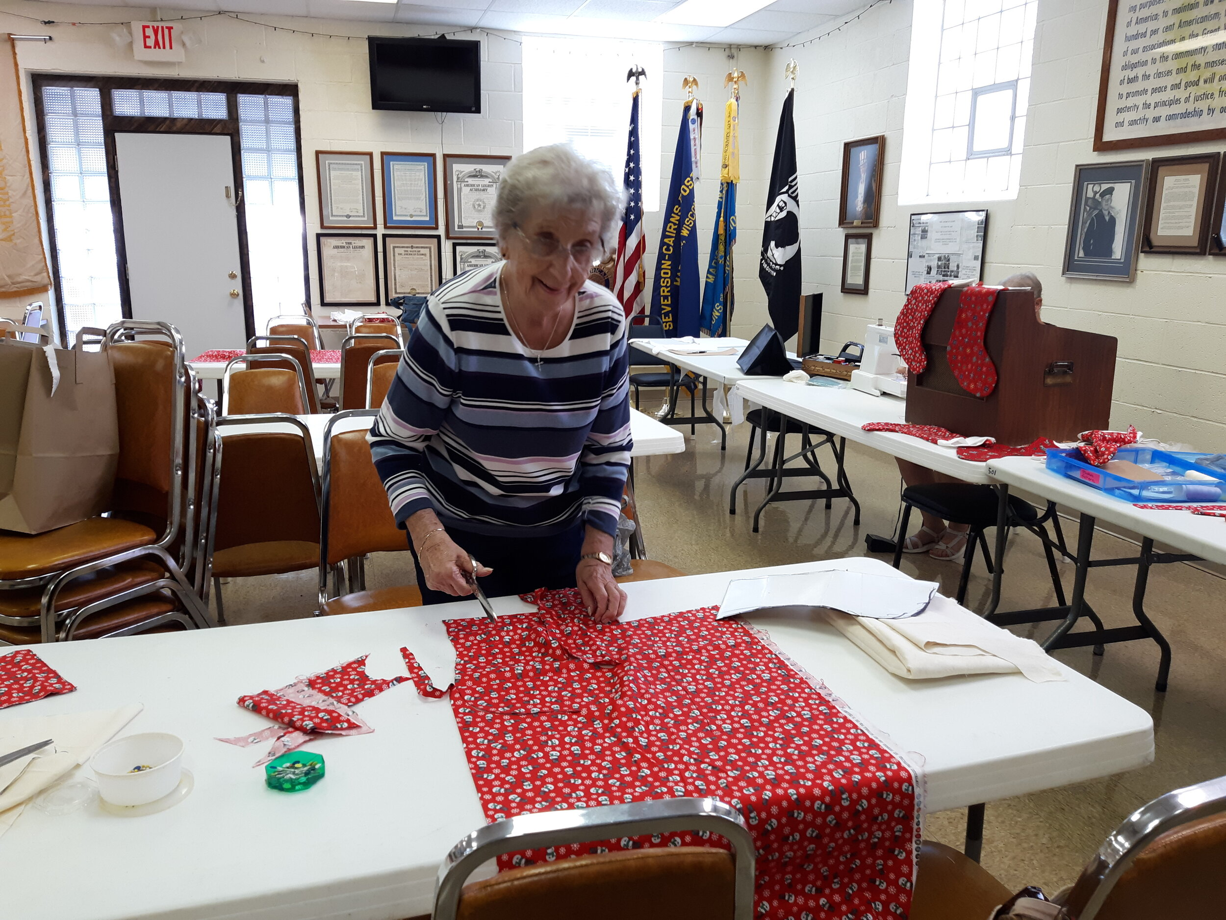 Ellie cutting out stocking patterns for Christmas stockings for VA Hospital on Aug. 29, 2019.
