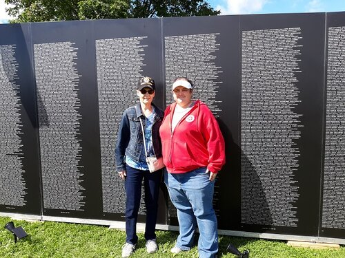 Legionnaire Chris Robbins and Unit 501 Auxiliary Pres. Rebecca Lovell visiting the  American Vietnam Traveling Tribute Wall at the Celebration of Freedom in Portage, WI, 9/6/2019.