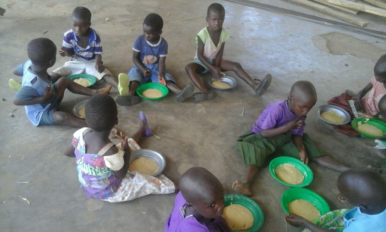 Kids eating Likhuni Pala (locally produced, high nutrition porridge) at nursery school.