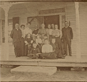 "family photograph on the ""Victorian"" porch"