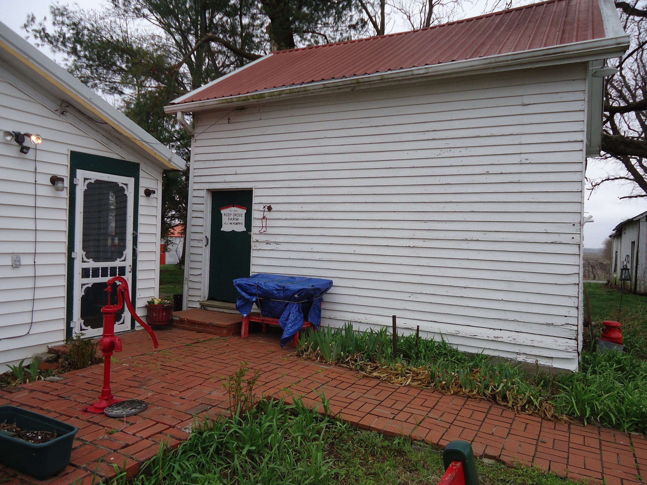 The Smokehouse and the old pump.JPG