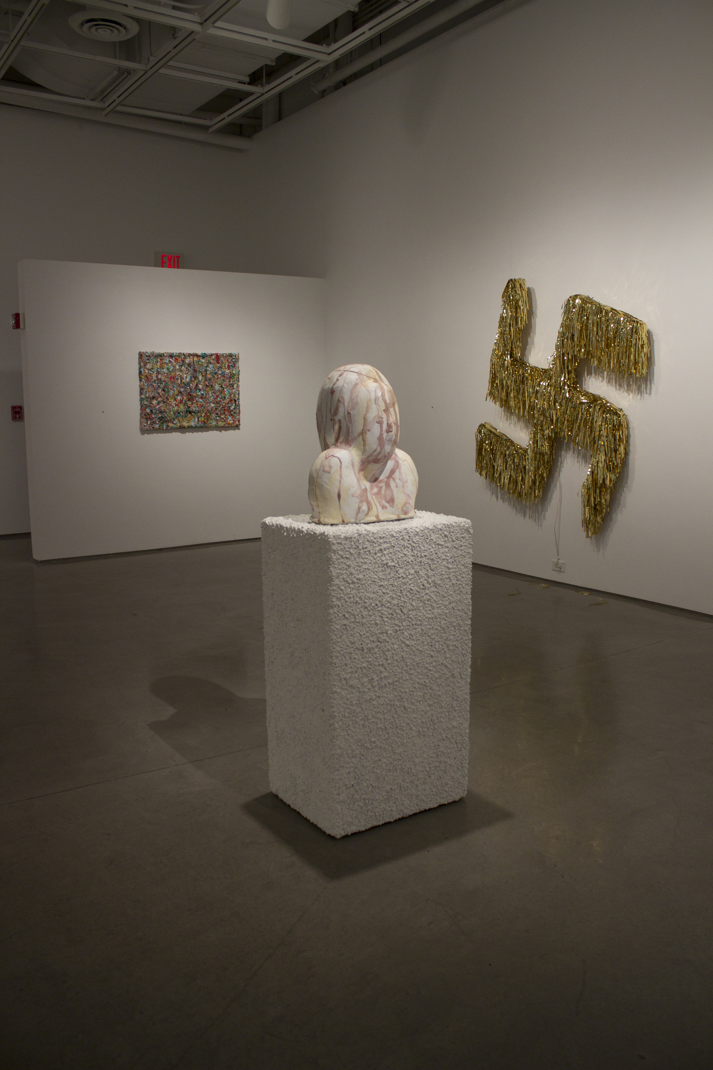 "Left: Gum Screen   Center:  Gum Girl  Ceramic, epoxy, plaster, water putty, plaster, paint, gum, pea gravel, glue 65""x21""x16"" 2015  Right:  All Is Well"