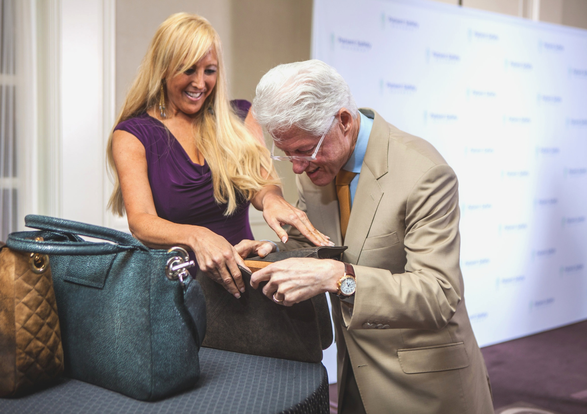 JAMAH Founder/Designer Nancy Gale with President Bill Clinton, presenting the JAMAH Clinton Collection.