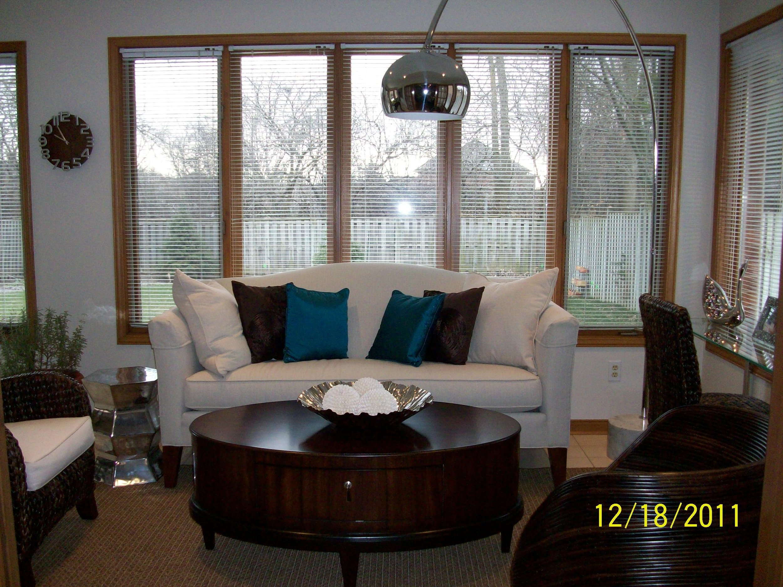 Mississauga living room with cream couch and blue pillows - dark walnut coffee table - free standing lamp.jpeg