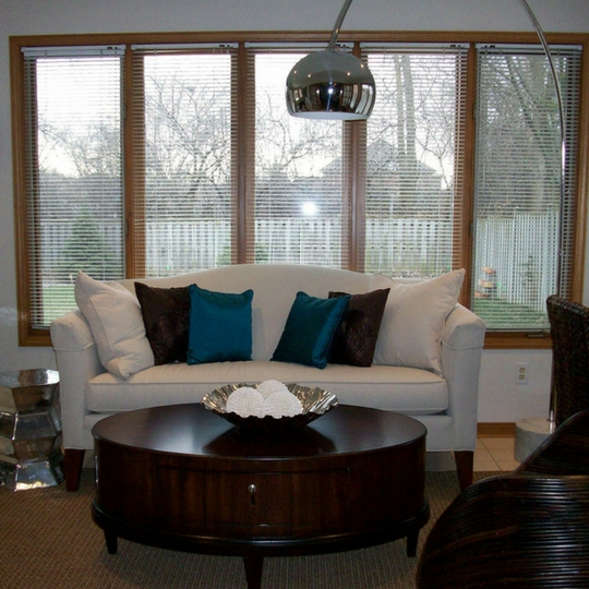 Mississauga living room with cream couch and blue pillows - dark walnut coffee table - sea grass area rug.jpeg