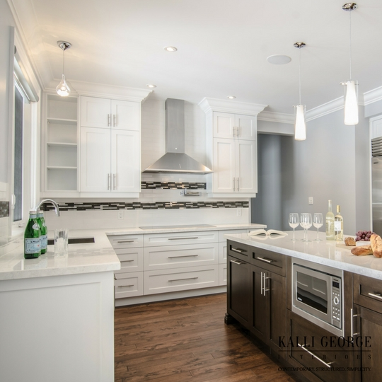 Toronto design build home with white kitchen - walnut stain island - subway tile and mosaic backsplash.jpeg