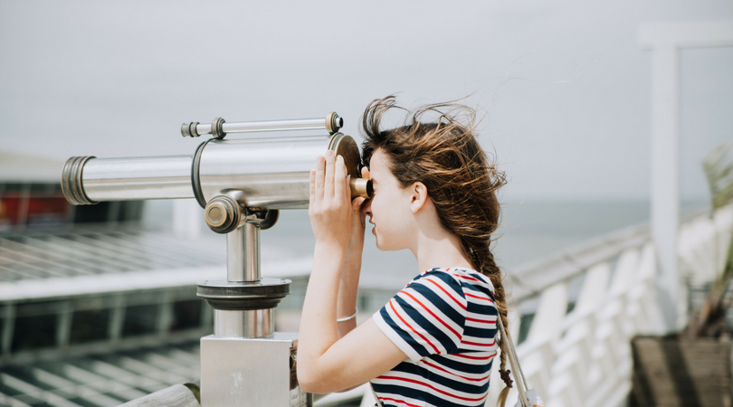 Toronto-interior-design-firm-woman-looking-through-telescope-client-discovery.jpeg