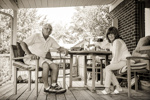 Grandparents sitting at a picnic table.