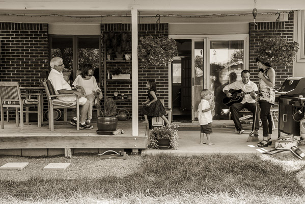 Family playing on a porch.