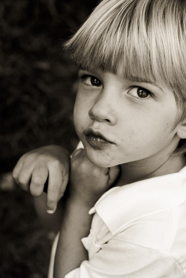 Adorable blone boy looking serious.
