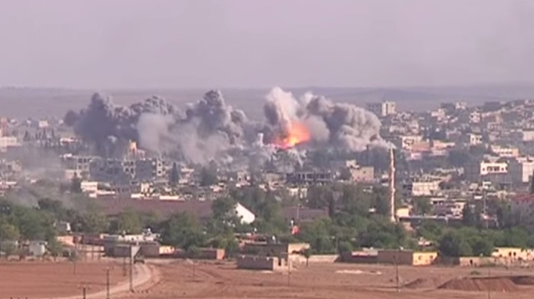 Coalition Airstrike on an Daesh position in 2014. Image Credit:  Public Domain (Screenshot from Voice of America)  via  Wikimedia Commons