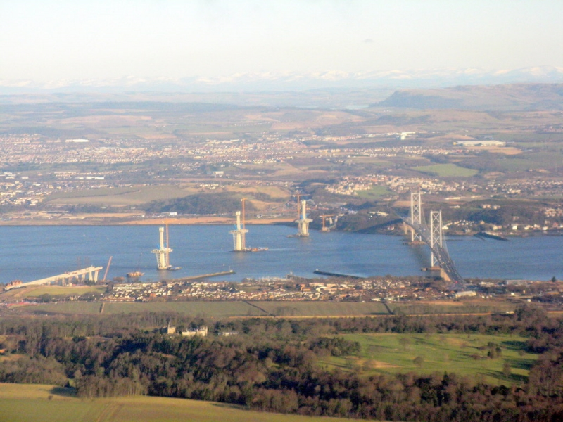 Aerial view of the Firth of Forth towards Fife. At left is the emerging Queensferry Crossing adjacent to the FortH Road Bridge.  Image Credit : © Copyright  M J Richardson  and licensed for reuse under this  Creative Commons Licence