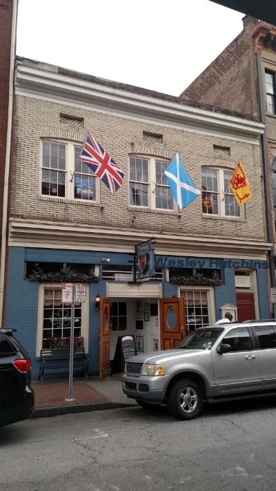 Molly MacPherson's Scottish Pub and Grill in Downtown Savannah with the Union Flag, Saltire, and Lion Rampant. Image Credit: Wesley Hutchins