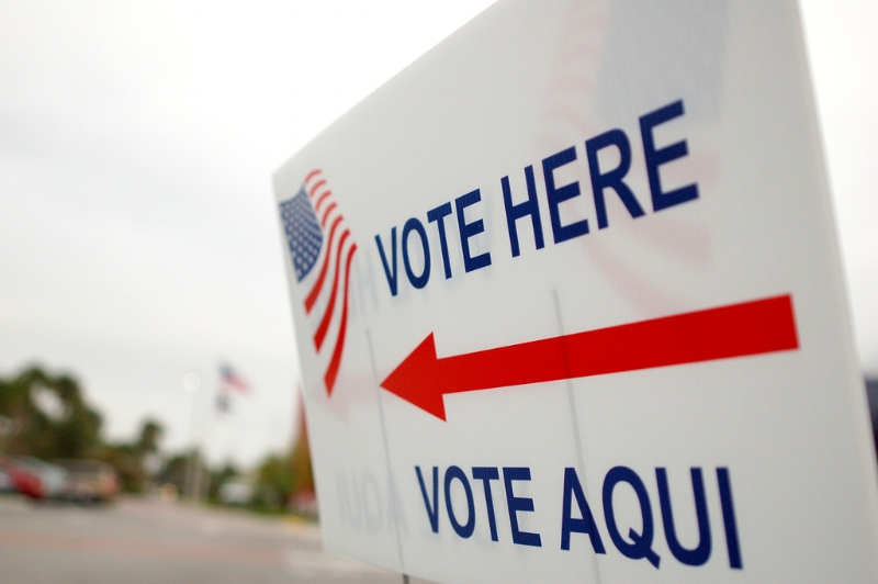 """Vote Here/Vote Aqui"" sign in Orlando, Florida - 2008. Image Credit:  Erik (HASH) Hershman  via  Flickr   CC"