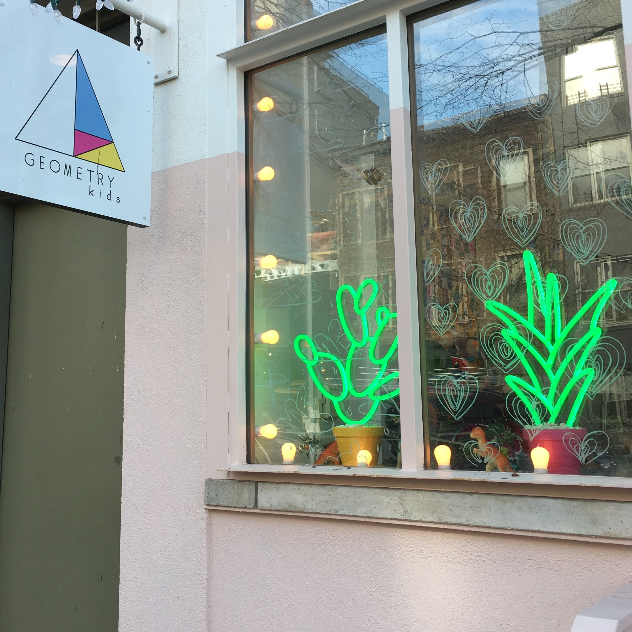 Our Pear Cactus and Aloe Vera LED neons in the window