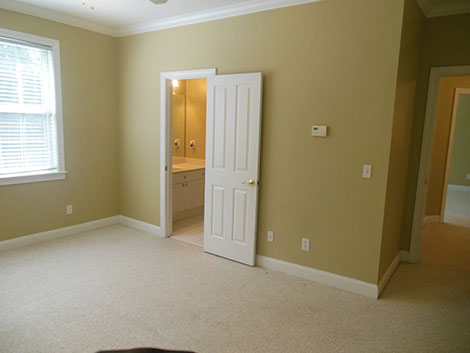 With this bedroom shot, we really see what not having a wide angle lens does to your pictures. You can only see a little part of the windows, and barely see through the door into the hallway. Plus, again, our windows are glowing, and wall colors are wrong.