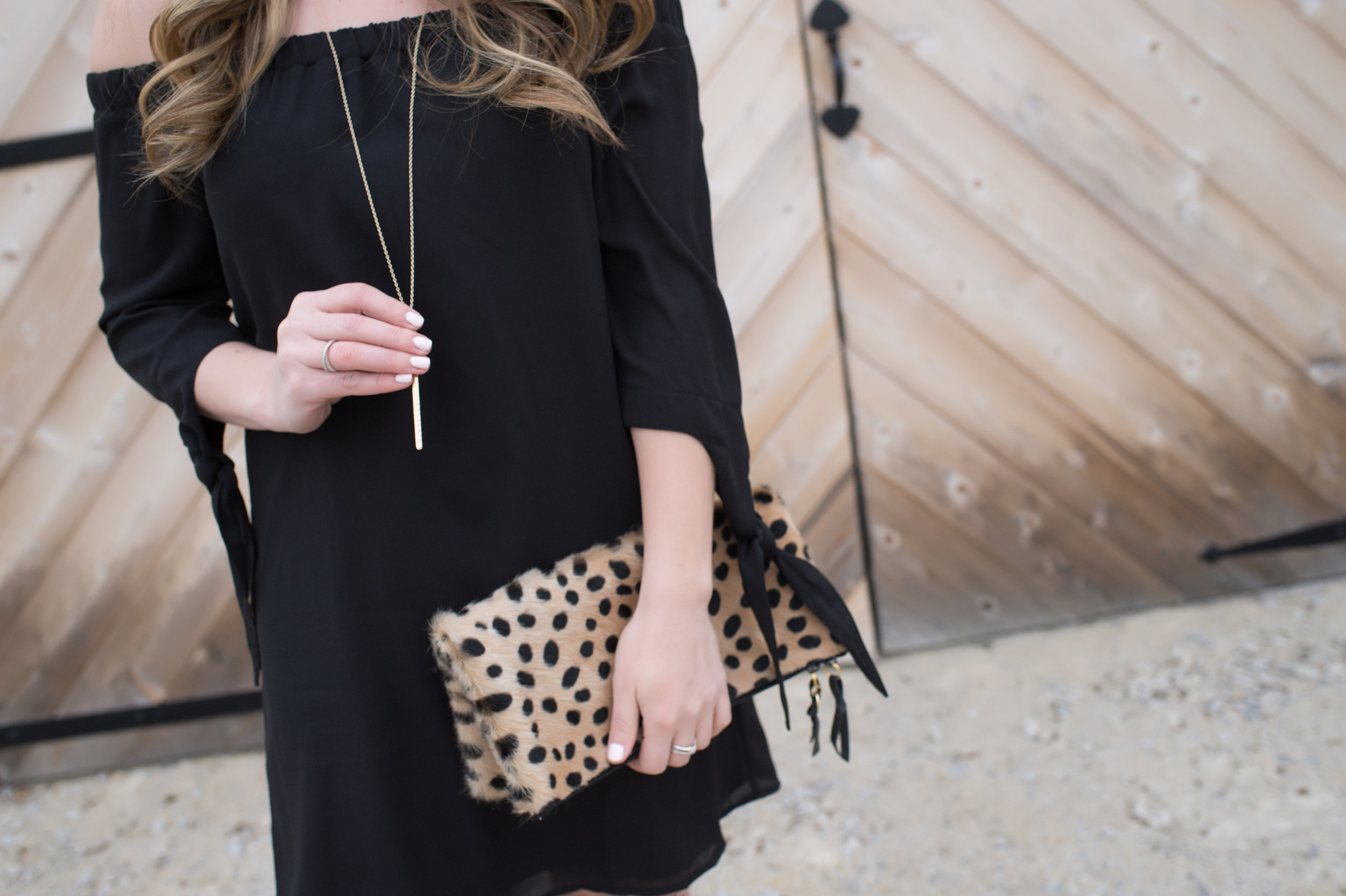 outfit details / gold necklace + cheetah clutch