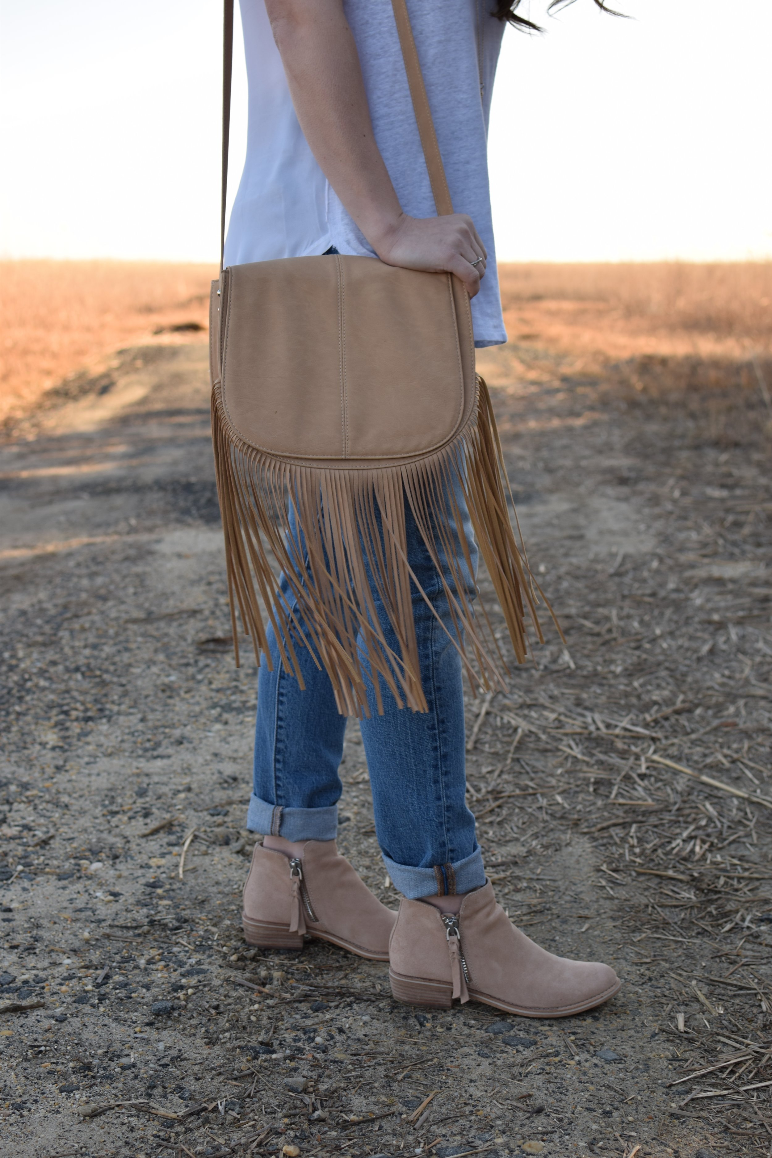 spring transition outfit idea / fringe cross body bag