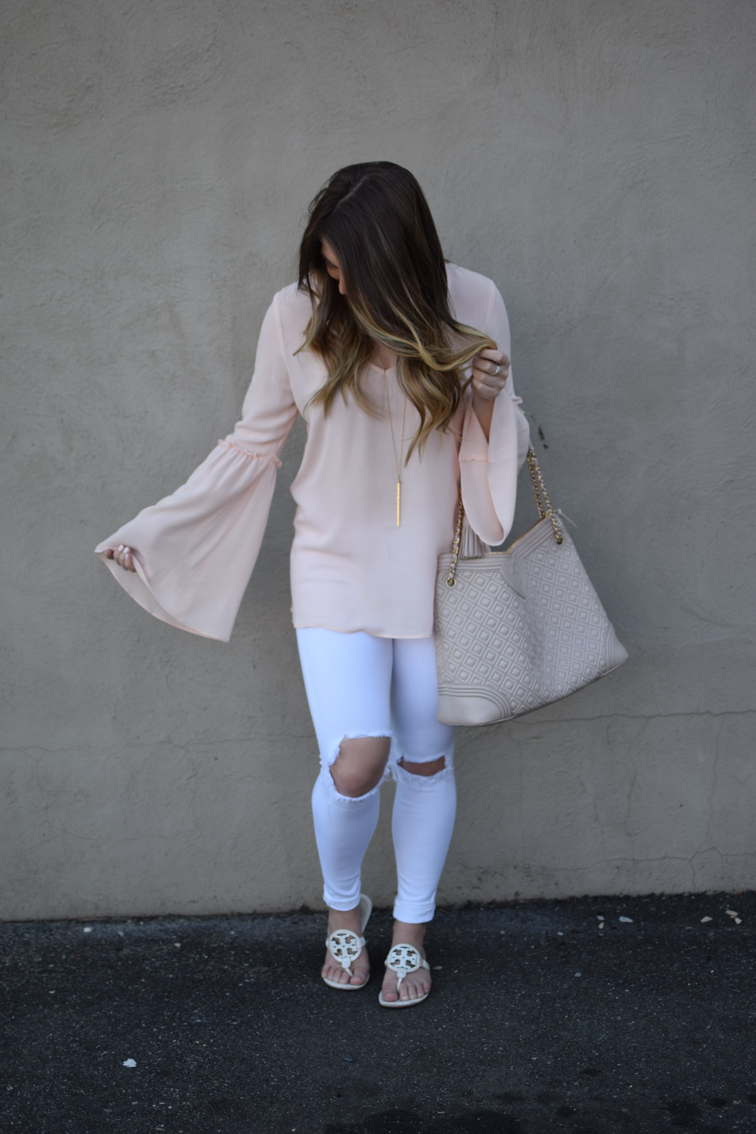 blush bell sleeve top / white distressed denim / tory burch miller sandal / nashelle layered necklaces / spring outfit idea