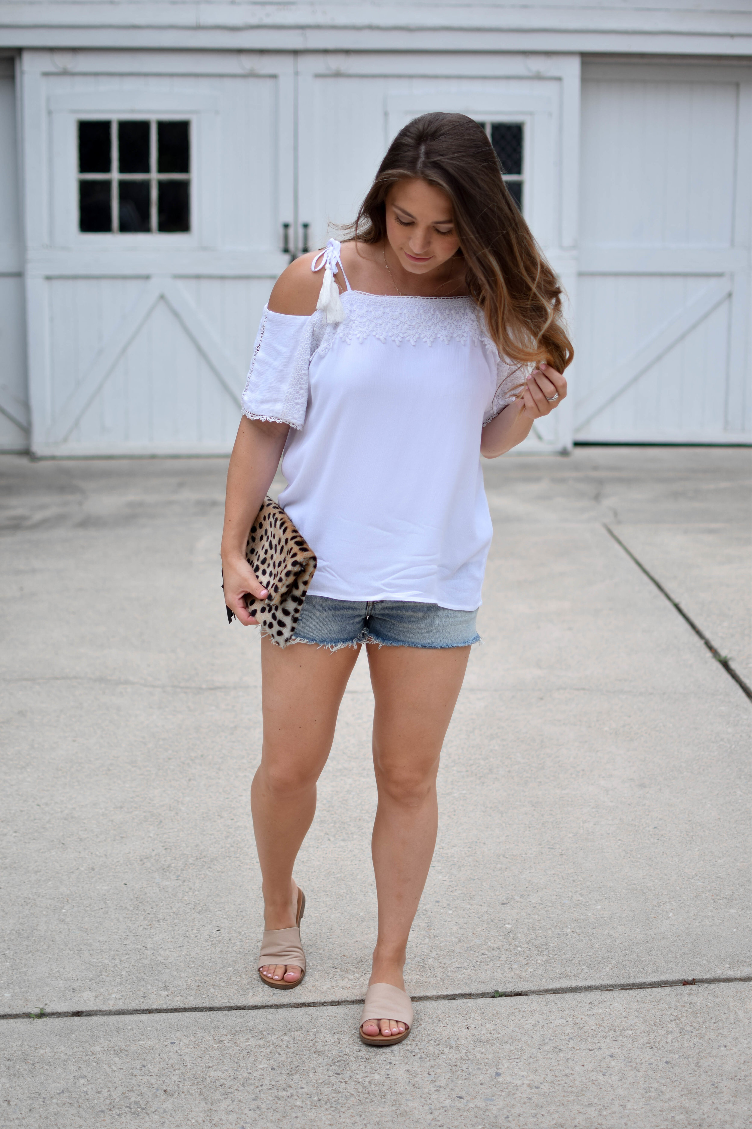 nell + rose white cold shoulder top, Levi's 501 denim cutoffs, Steve Madden slides, the providence story leopard clutch, summer outfit idea