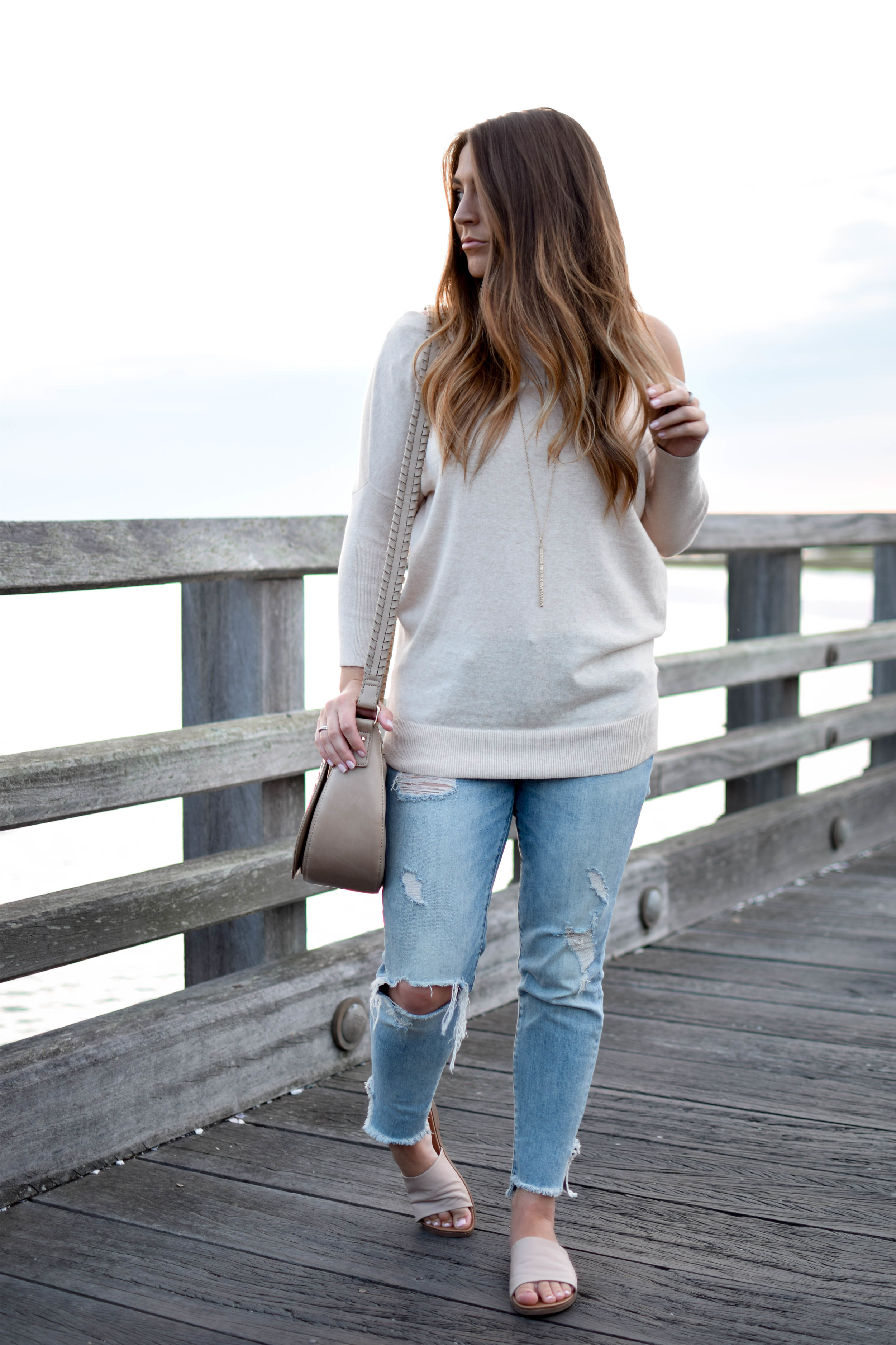 anthropologie off the shoulder sweater / distressed denim / summer outfit idea / fall transition outfit idea
