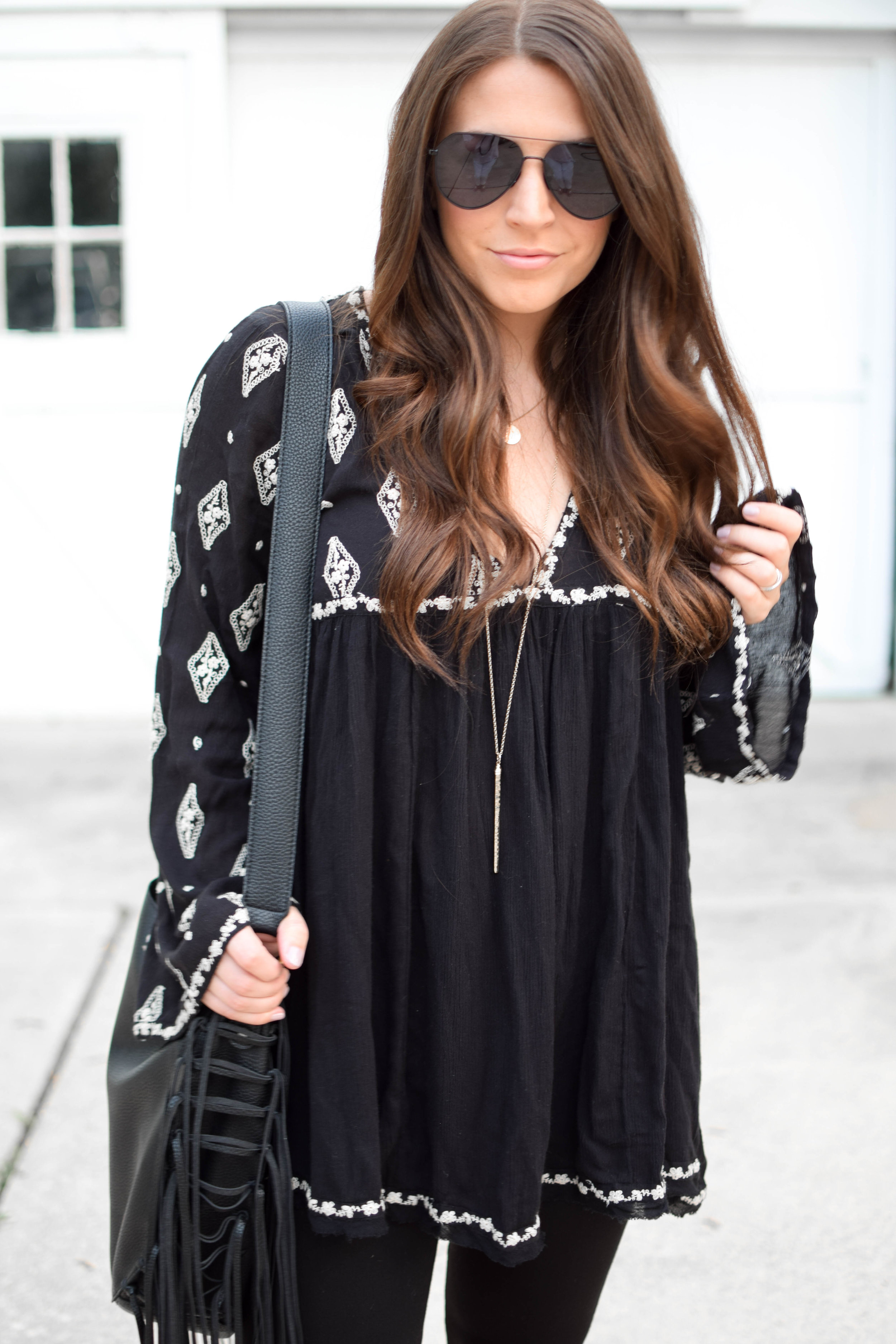 fall fashion / fall outfit idea / fall outfit inspiration / all black fall outfit / free people boho top / madewell black denim / diff eyewear