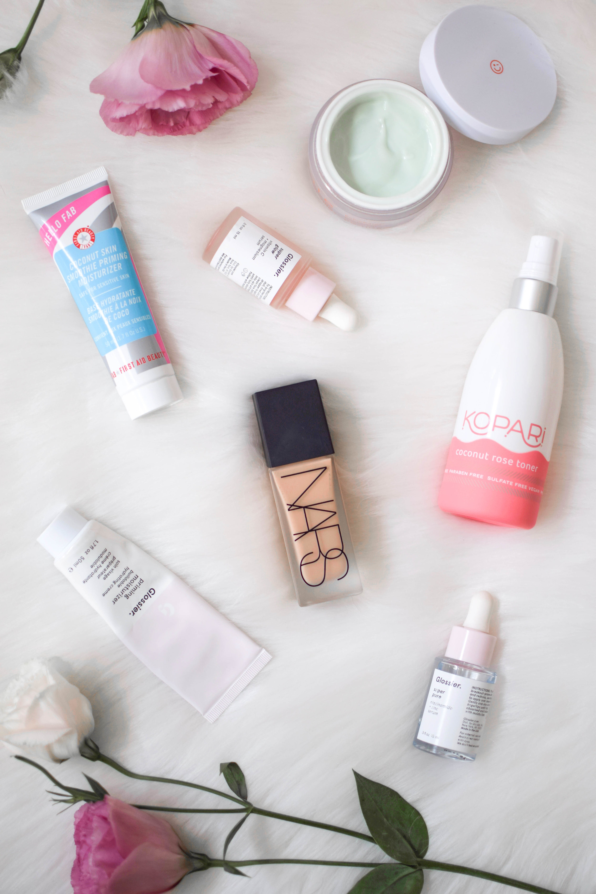 every day makeup routine / makeup product flat lay / beauty product flat lay / how to style a flat lay / nars / glossier / kopari / first aid beauty / kate somerville