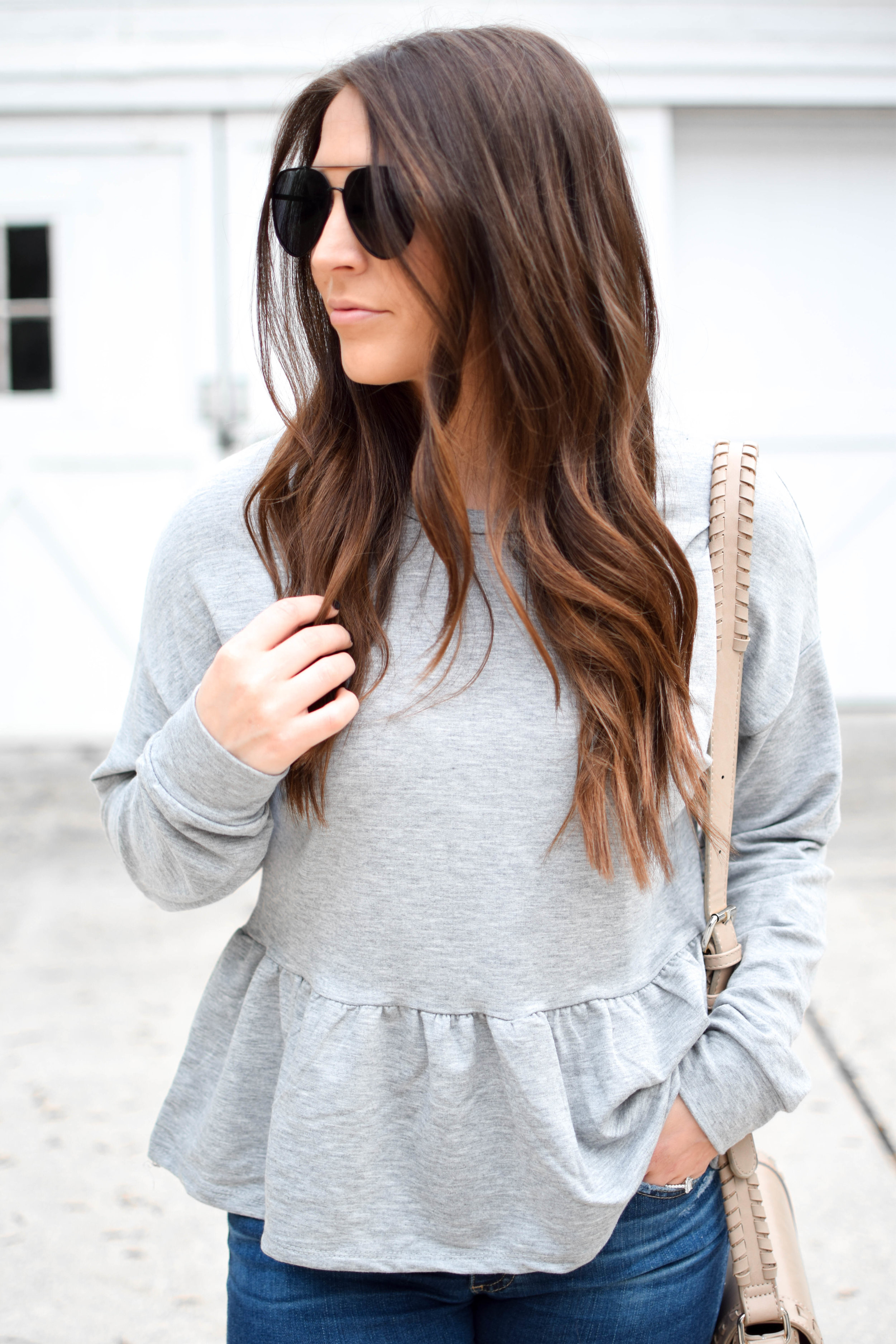 fall outfit idea / fall outfit inspiration / fall fashion / grey peplum sweatshirt / casual outfit for fall