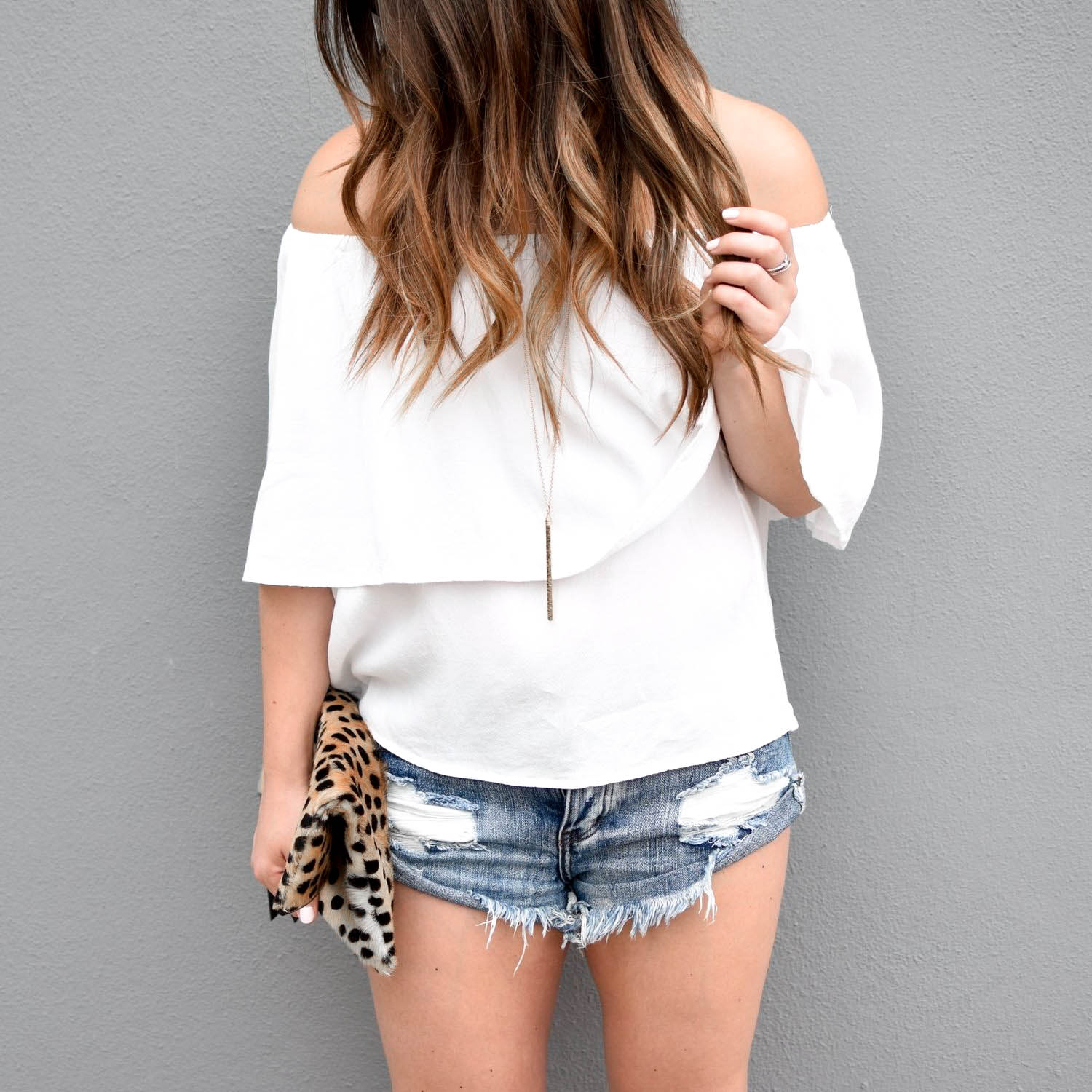 summer outfit idea / white off the shoulder top / summer outfit inspiration / denim cutoff shorts