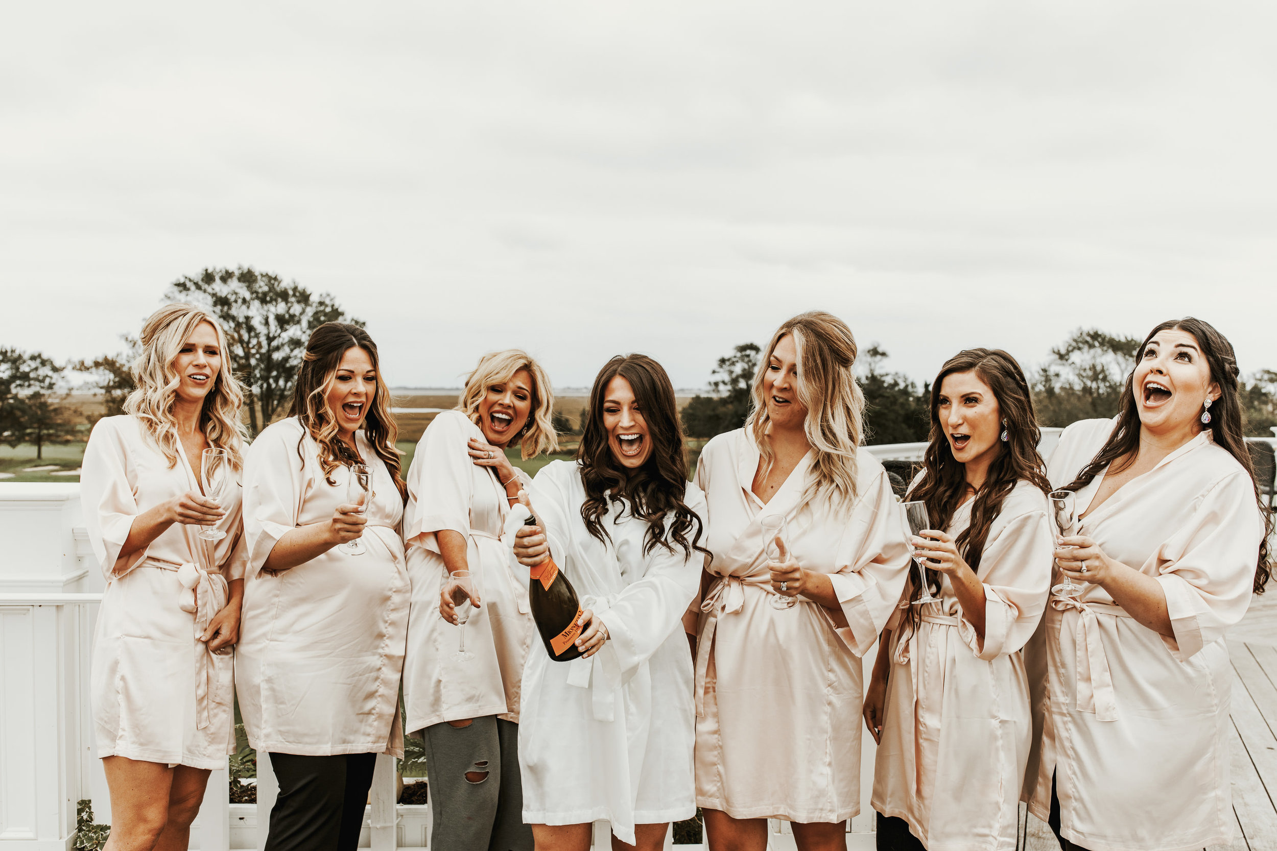 Champagne pop = must have bridal party photo