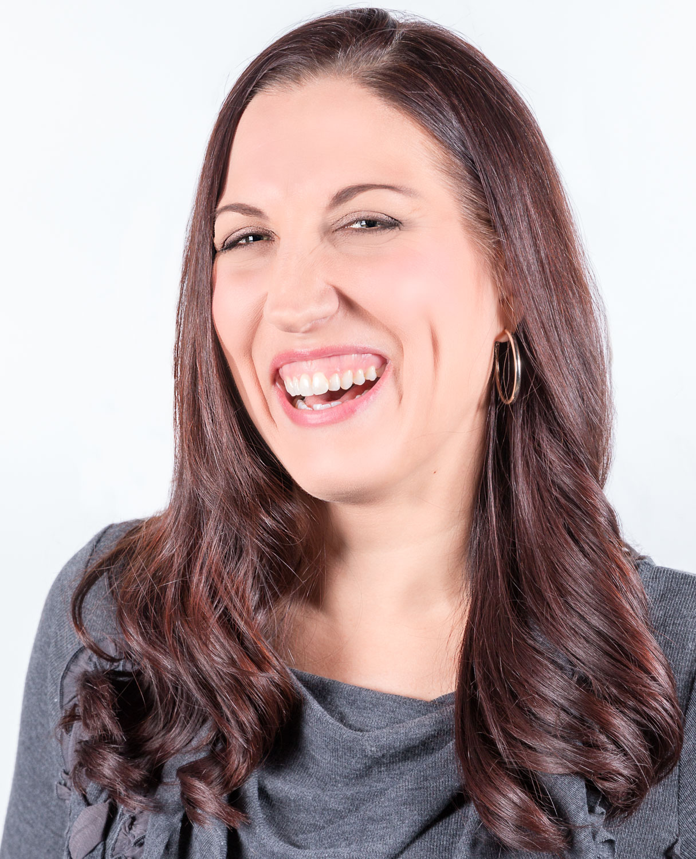 female_professional_headshot_laugh_.jpg
